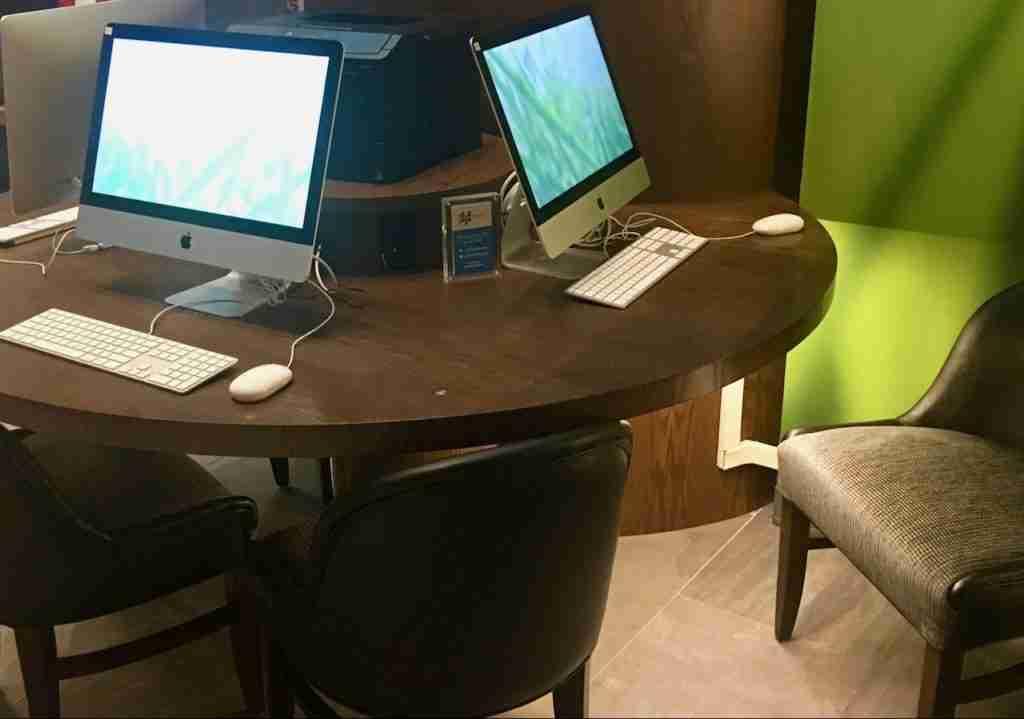 iMacs near dining area at EVEN Hotel, New York, NY